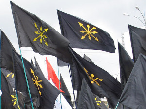 black flags with gold, eight-pointed star